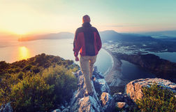 Man on the cliff. Man on the sheer cliff Royalty Free Stock Photo