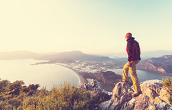 Man on the cliff. Man on the sheer cliff Stock Images