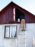 Man climb the stairs in attic in romanian country house Stock Images