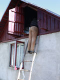 Man climb the stairs in attic in romanian country house Stock Photo