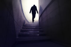 Man climb up from darkness to reach progress. Render illustration Stock Photo