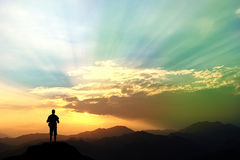 A man climbed the mountain. Royalty Free Stock Image