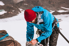 Man climber packing backpack mountains alpinism Royalty Free Stock Photo