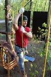 Man climbing at adventure park Royalty Free Stock Photos