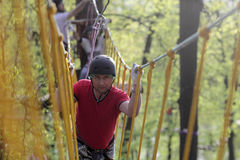 Man climbing in the adventure park Royalty Free Stock Image