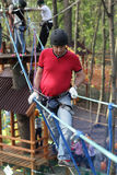 Man climbing in adventure park Royalty Free Stock Photography