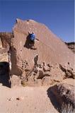 Man climbing boulder Royalty Free Stock Photo