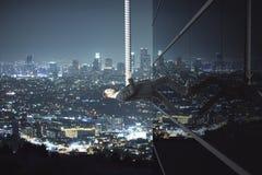 Man climbing building at night Royalty Free Stock Image