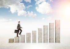 Man climbing chart bars Royalty Free Stock Images
