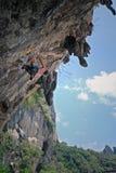 Man climbing cliff Stock Images