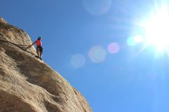 Man climbing cliff Stock Photography