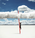 Man climbing on clouds Royalty Free Stock Photos