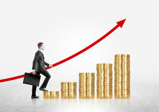 Man climbing coin ladder Royalty Free Stock Photography