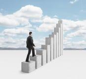 Man climbing a column Royalty Free Stock Image