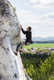 Man climbing difficult rocky wall. Royalty Free Stock Photos