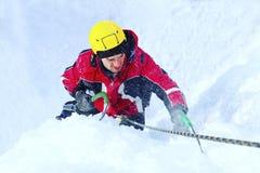 Man climbing frozen waterfall. royalty free stock photos