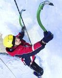 Man climbing frozen waterfall. royalty free stock photo