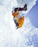 Man climbing frozen waterfall. Royalty Free Stock Photography