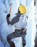Man climbing frozen waterfall. Stock Photography