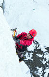 Man climbing frozen waterfall Royalty Free Stock Image