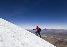 Man climbing on glacier of Sajama Volcano in Bolivia Royalty Free Stock Image