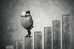 Man climbing graph with stone and partner Stock Photos