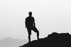Man climbing hiking inspiration landscape, travel silhouette Stock Images