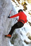 Man climbing on ice. Man climbing on frozen waterfall in winter Royalty Free Stock Photos