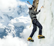 Man climbing on icefall in winter mountains Stock Image