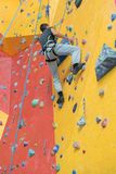 Man climbing indoors at gym Royalty Free Stock Images