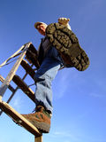 Man Climbing Ladder. Healthy, middle-aged man working with ladder Royalty Free Stock Images