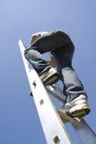 Man climbing ladder. In sky royalty free stock image