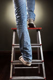 Man climbing on ladder Royalty Free Stock Photos