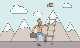 Man climbing the ladder Royalty Free Stock Photography