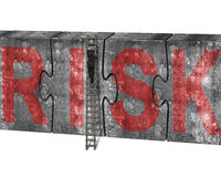 Man climbing ladder puzzles concrete wall red risk word Stock Photo
