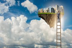 The man climbing ladder to floating island Stock Images