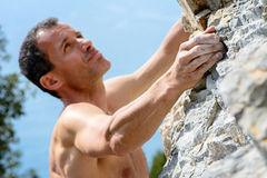 Man climbing on limestone Royalty Free Stock Photos