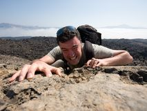 Man climbing a mountain Royalty Free Stock Photo