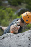 Man climbing a mountain. With a camming device in his hand Royalty Free Stock Photography