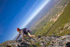 Man Climbing a mountain Stock Image