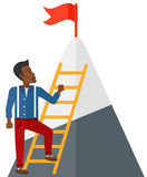 Man climbing on mountain Stock Photo