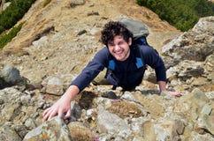 Man climbing a mountain Stock Photos