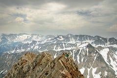 Man Climbing Mountain Ridge Royalty Free Stock Images