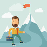 The Man Climbing the Mountain of Success Royalty Free Stock Images
