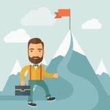 The Man Climbing the Mountain of Success Stock Image
