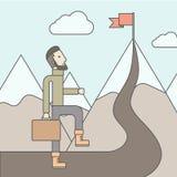 The Man Climbing the Mountain of Success Stock Photo