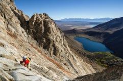 Man Climbing Mountain. Man climbing up Laurel Mountain above Convict Lake stock photo