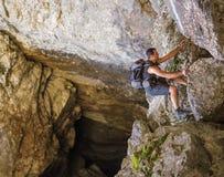 Man climbing mountain wall Royalty Free Stock Images