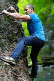 Man climbing mountain wall Royalty Free Stock Images