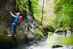 Man climbing mountain wall Royalty Free Stock Image